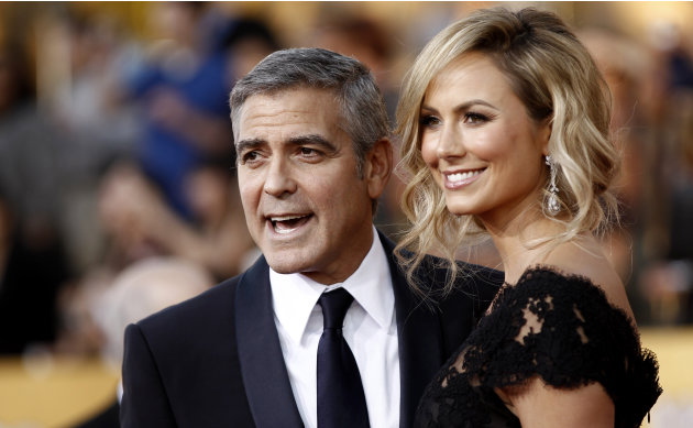George Clooney, left, and Stacy Keibler arrive at the 18th Annual Screen Actors Guild Awards on Sunday Jan. 29, 2012 in Los Angeles. (AP Photo/Matt Sayles)