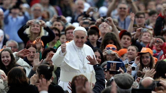 Pope Francis waves to faithful as he is driven through the crowd with his popemobile in St. Peter's Square prior to the start of his weekly general audience at the Vatican, Wednesday, April 10, 2013. (AP Photo/Alessandra Tarantino)