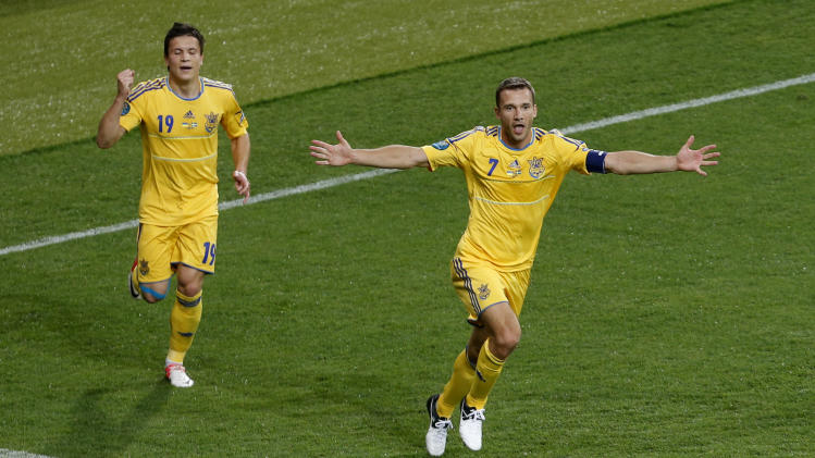 Ukraine's Andriy Shevchenko celebrates after he scored his team's second goal, as teammate Ukraine's Yevhen Konoplyanka run in to congratulate him,  during the Euro 2012 soccer championship Group D match between Ukraine and Sweden in Kiev, Ukraine, Monday, June 11, 2012.  (AP Photo/Darko Vojinovic)