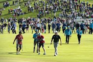 England's Lee Westwood (front R) is followed by camera men after winning the Nordea Masters golf tournament, a European Tour event, at Bro Hof golf club in Sweden