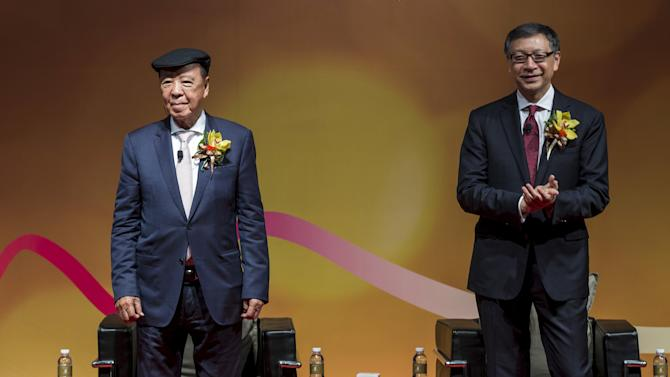Billionaire Lui and his son Francis, deputy chairman of Galaxy Entertainment Group, attend a news conference for the opening of a new section of Galaxy Macau resort in Macau