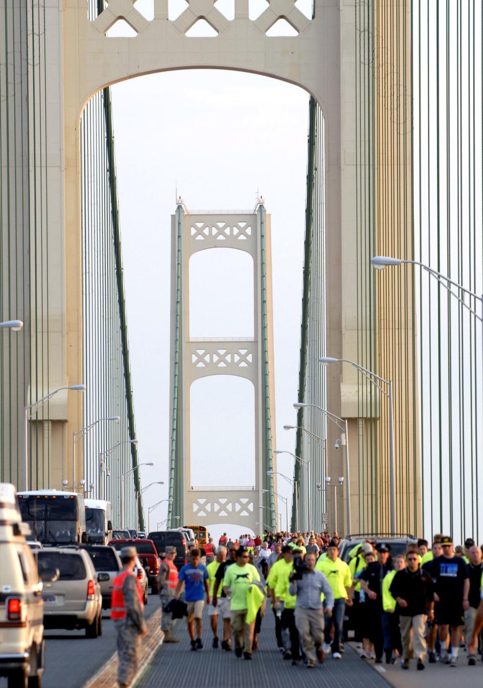 Michigan Gov. Rick Snyder leads the annual Labor Day Mackinac Bridge Walk, Monday, Sept. 3, 2012, across the five-mile span that connect Michigan's upper and lower peninsulas. (AP Photo/John L. Russell)