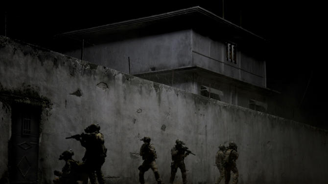 "FILE - This undated publicity film image provided by Columbia Pictures Industries, Inc. shows elite Navy SEALs raiding Osama Bin Laden's compound in the dark night in Columbia Pictures' gripping new thriller directed by Kathryn Bigelow, ""Zero Dark Thirty."" (AP Photo/Columbia Pictures Industries, Inc., Jonathan Olley, File)"