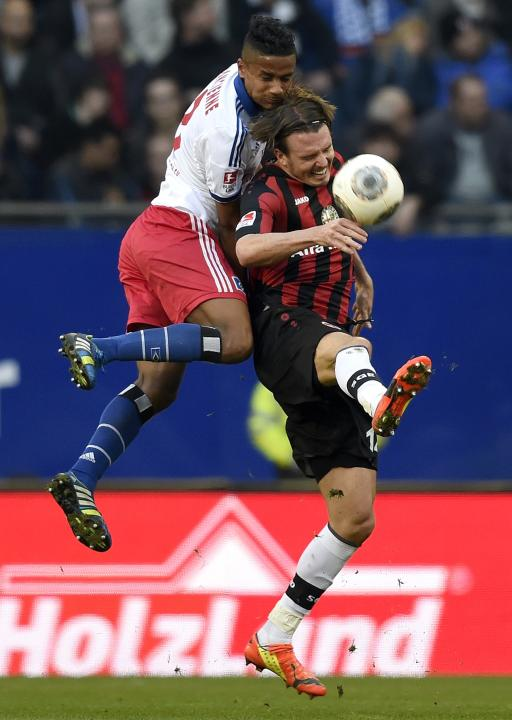 Hamburg SV's Mancienne and Eintracht Frankfurt's Meier fight for the ball during their German Bundesliga first division soccer match in Hamburg