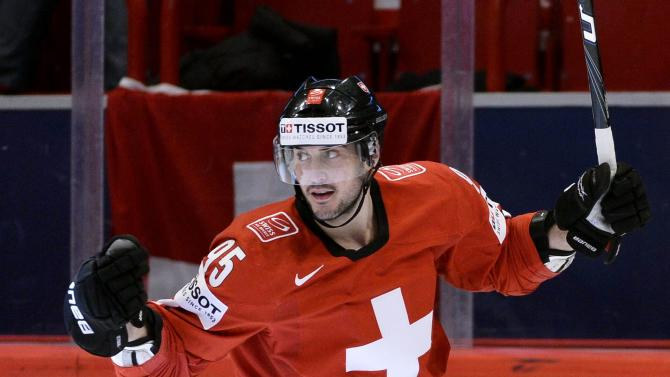 Switzerland's Julian Walker reacts after the 4-1 goal against Slovenia during the Ice Hockey World Championship group A match in Stockholm, Sweden, Tuesday May 8, 2013. (AP Photo/Anders Wiklund/Scanpix) SWEDEN OUT