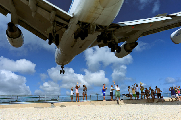 Duck! Thrill-seeking people are heading to a beach on the Caribbean island of St. Maarten, where Boeing 747s fly so low that they darken the skies. A perfect and unique way to start your day in St. Ma