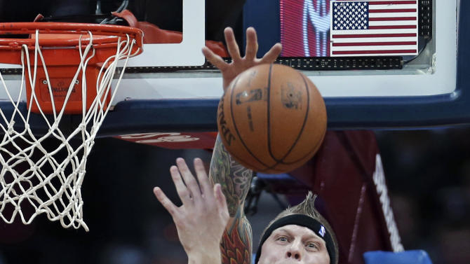Miami Heat's Chris Andersen, rear, blocks a shot by Cleveland Cavaliers' Tyler Zeller during the third quarter of an NBA basketball game Wednesday, March 20, 2013, in Cleveland. Miami won 98-95. (AP Photo/Tony Dejak)