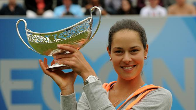 Serbia's Ana Ivanovic holds the trophy after winning the final against Czech Republic's Barbora Zahlavova Strycova at the Aagon Classic at Edgbaston Priory Club, Birmingham central England Sunday June 15, 2014. (AP Photo/Rui Vieira/PA) UNITED KINGDOM OUT