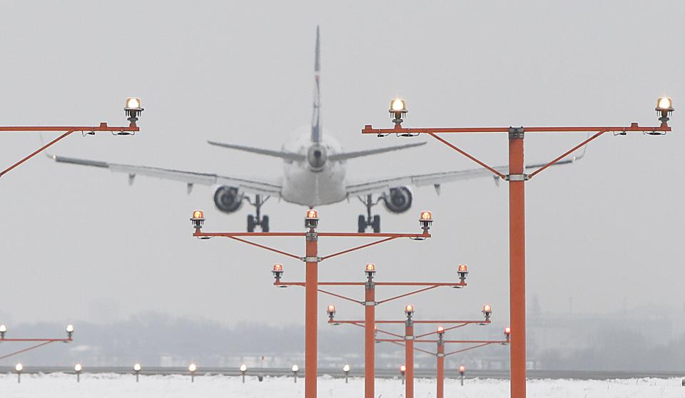 A Boeing 767 of the Polish airlines LOT landing at  the Frederic Chopin airport in Warsaw, Poland, on Friday, Feb. 22, 2013.  On March 20 the  company is to present a rescue plan of  layoffs and major restructuring in an effort to stave off bankruptcy. (AP Photo/Czarek Sokolowski)
