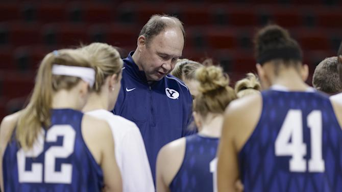 BYU coach Jeff Judkins and players take time to pray prior to NCAA college basketball practice in Lincoln, Neb., Friday, March 28, 2014. BYU will play Connecticut in a Lincoln Regional women's semifinal basketball game on Saturday. (AP Photo/Nati Harnik)