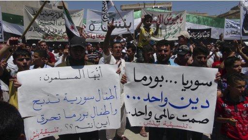 Demonstrators protest against Syria's President Bashar al-Assad after Friday Prayers in Binsh