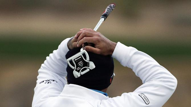 Australia's Jason Day reacts after missing a putt on the third green in the semifinal round of play against Matt Kuchar during the Match Play Championship golf tournament, Sunday, Feb. 24, 2013, in Marana, Ariz. (AP Photo/Julie Jacobson)