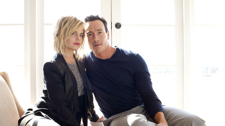 "In this March 18, 2012 photo, actress Mena Suvari, left, and actor Chris Klein pose for a portrait during a media day for the upcoming feature film ""American Reunion"" in Los Angeles. The film opens nationwide on Friday, April 6. (AP Photo/Dan Steinberg, file)"