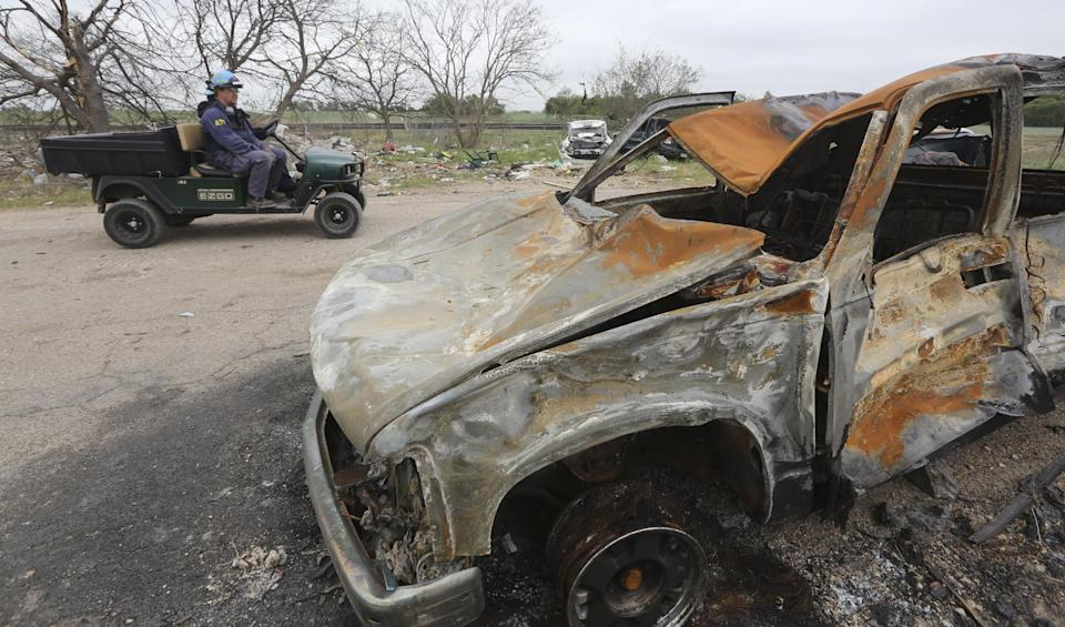 Investigator drive past a burned truck during their investigation of the destroyed fertilizer plant in West, Texas, Thursday, May 2, 2013. Investigators face a slew of challenges in figuring out what caused the explosion at the fertilizer plant that killed 14 people and destroyed part of the small Texas town. (AP Photo/Pool/ LM Otero)