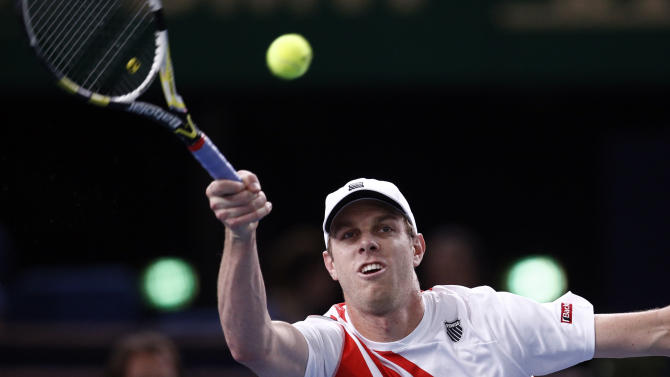 Sam Querrey of the U.S returns the ball to Novak Djokovic of Serbia during their match at the Paris Tennis Masters tournament, Wednesday, Oct. 31, 2012. (AP Photo/Christophe Ena)