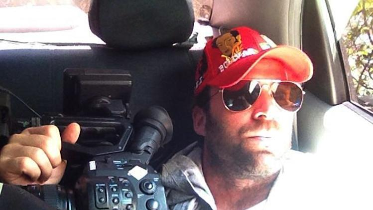 This undated family photo released Thursday, April 25, 2013, shows Timothy Tracy inside of a vehicle in Venezuela. The U.S. filmmaker, who was jailed on espionage charges in Venezuela, has been released and is on his way back to the United States, says his sister Tiffany Tracy. Family and friends say the 35-year-old Hollywood producer and actor had been making a documentary about Venezuelan politics when he was arrested on April 24 at Caracas' airport as he tried to leave the country to attend his father's 80th birthday in suburban Detroit. (AP Photo/Family courtesy photo, File)