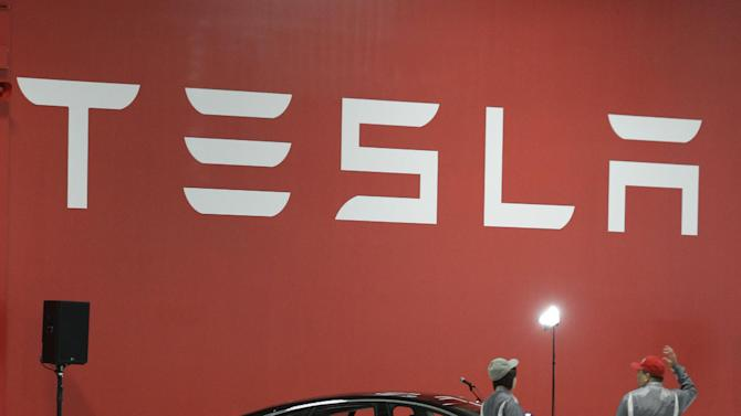 A Tesla Model S on display at the Tesla factory in Fremont, Calif., Friday, June 22, 2012. The first Model S sedan car will be rolling off the assembly line on Friday.  (AP Photo/Paul Sakuma)