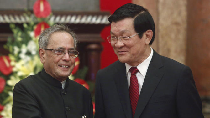 India's President Pranab Mukherjee shakes hands with Vietnamese counterpart Truong Tan Sang at the Presidential Palace in Hanoi