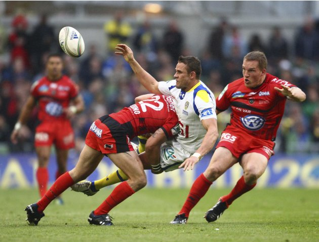 Clermont's Lee Byrne is tackled by Frederic Michalak of Toulon during the Heineken Cup rugby tournament final in Dublin