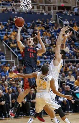 Kilicli helps West Virginia edge Texas Tech 66-64