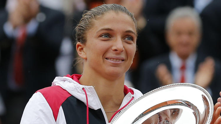 Sara Errani of Italy holds the second place trophy after losing the women's final to Maria Sharapova of Russia at the French Open tennis tournament in Roland Garros stadium in Paris, Saturday June 9, 2012. Sharapova won in two sets 6-3, 6-2. (AP Photo/Michel Euler)