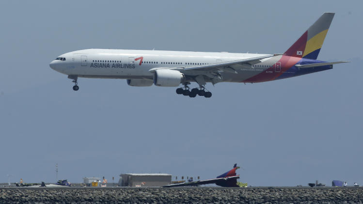 Asiana posts loss as NKorea, bird flu dent travel