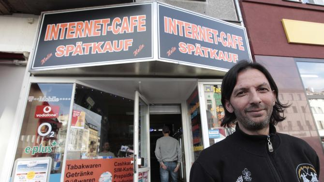 Kadir Anlayisli stands next to the internet cafe in the district of Neukoelln in Berlin, Germany, Monday, June 4, 2012, where he recognized Luka Rocco Magnotta. Kadir Anlayisli  who works in the after hours liqueur and tobacco shop with internet cafe, called a police man from outside saying he recognized the suspect person. Magnotta is wanted by Canadian authorities on first-degree murder and other charges. He is suspected of killing Jun Lin  a 33-year-old Chinese university student he dated and mailing Lin's body parts to Canadian political parties. (AP Photo/Markus Schreiber)