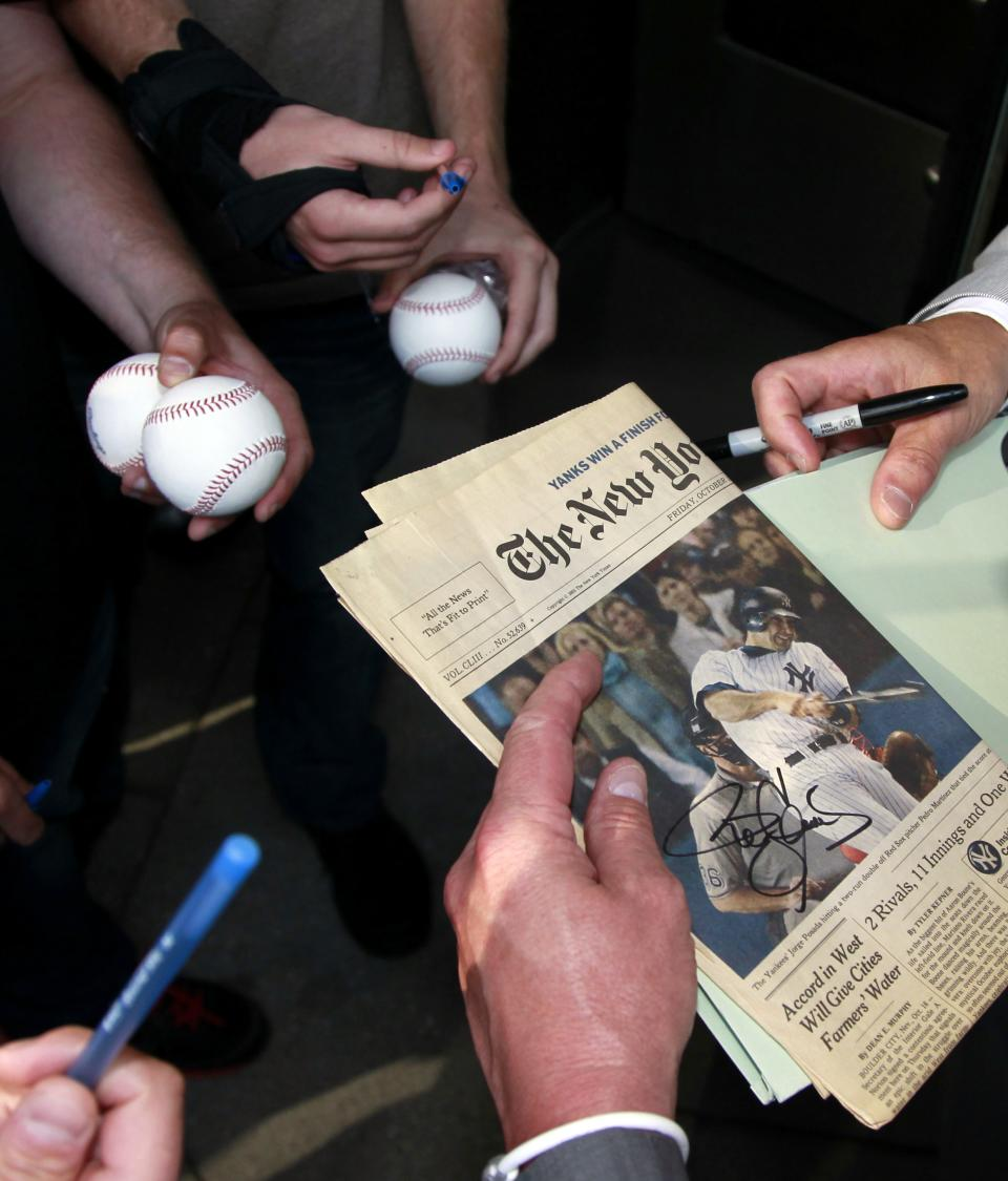 Autograph seekers wait for Former Major League Baseball pitcher Roger Clemens to sign autographs after signing a newspaper , Thursday, May 17, 2012, in Washington, as his perjury trial concluded for the day. (AP Photo/Haraz N. Ghanbari)