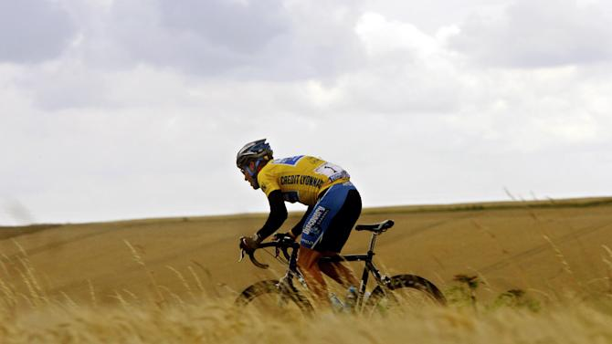 FILE - In this July 7, 2005, file photo, Lance Armstrong rides through the countryside during the sixth stage of the Tour de France cycling race between Troyes and Nancy, eastern France. In 2005, Armstrong was also named Associated Press Male Athlete of the Year and ESPN's ESPY Award for Best Male Athlete. He later announced what would be a temporary retirement from cycling in 2005. (AP Photo/Alessandro Trovati, File)
