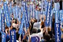 Delegates carry signs on the final day of the 2016 Democratic National Convention on July 28, 2016 in Philadelphia, Pennsylvania