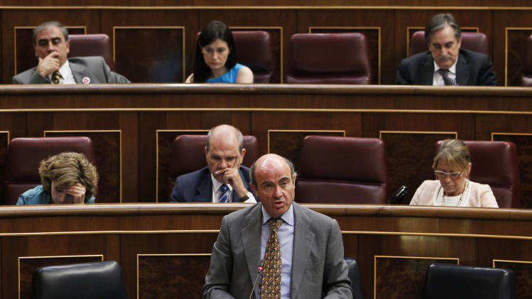 Spain's Economy Minister Luis De Guindos, centre bottom, speaks during a control session at the Spanish Parliament, in Madrid, Spain, Wednesday, June 27, 2012. Spain's central government budget deficit has soared to 3.41 percent of GDP in the first five months of 2012, just 0.09 percent below the figure agreed upon with the European Union for the entire year. Spain, with 24.4 percent unemployment, must slash its deficit to the EU limit of 3 percent of GDP by 2013. It was 8.5 percent in 2011, although the target had been 6 percent. (AP Photo/Andres Kudacki)