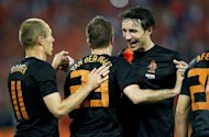 Dutch captain Mark van Bommel (R) with teammates Rafael van der Vaart (C) and Arjen Robben during their football friendly against Slovakia on May 30. The team will face their Danish opponents when they open their Euro 2012 campaign on Saturday