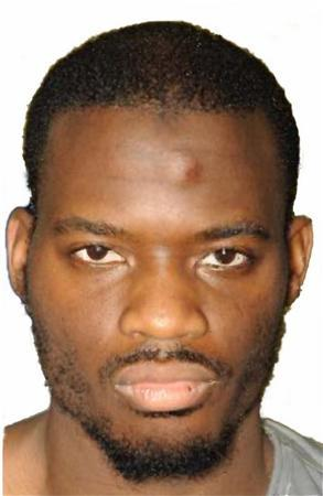 The police custody photograph of Adebolajo is seen in this image released by the court during the Lee Rigby murder trial at the Old Bailey, and received via the Metropolitan Police, in London