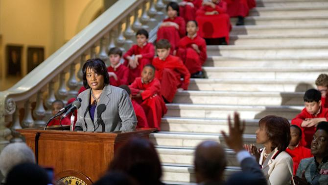 "In this Thursday, Jan. 17, 2013 photo, Bernice King, the daughter of Rev. Martin Luther King Jr., speaks during a service celebrating his birthday inside the Georgia State Capitol, in Atlanta. One of Rev. Martin Luther King Jr.'s quotes has been cited as one of America's essential ideals, its language suggestive of a constitutional amendment on equality: ""I have a dream that my four little children will one day live in a nation where they will not be judged by the color of their skin but by the content of their character."" Yet today, 50 years after the Rev. Martin Luther King Jr.'s monumental statement, there is considerable disagreement over what this quote means when it comes to affirmative action and other measures aimed at helping the disadvantaged. (AP Photo/David Goldman)"