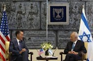 "Israeli President Shimon Peres (R) meets with US Republican presidential hopeful Mitt Romney in Jerusalem. Israel, which occupied the largely Arab eastern sector during the 1967 Six-Day War and later annexed it, claims both halves of Jerusalem to be its ""eternal and undivided capital"""