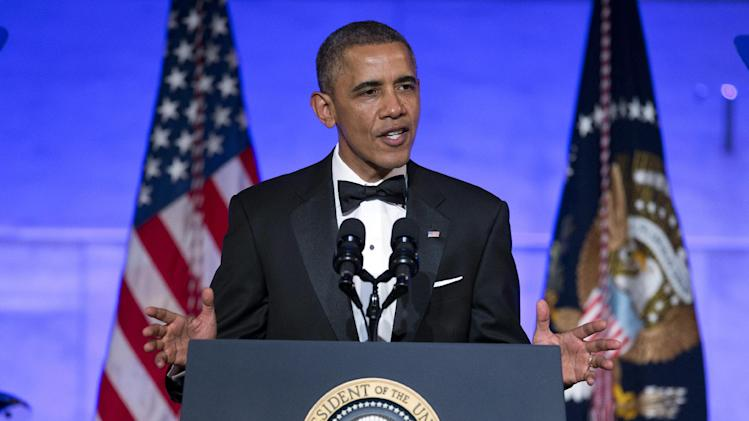 President Barack Obama gestures as he speaks during a dinner in honor of the Presidential Medal of Freedom awardees at the Smithsonian Museum of American History on Wednesday, Nov. 20, 2013 in Washington. (AP Photo/ Evan Vucci)
