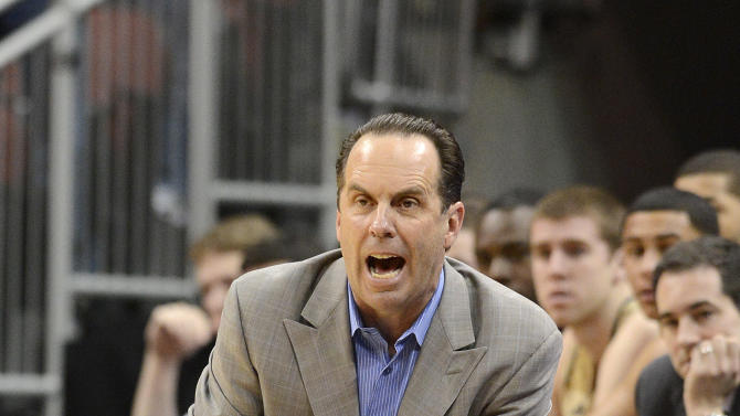 Notre Dame head coach Mike Brey shouts at his team during the first half of an NCAA college basketball game Saturday March 9, 2013 in Louisville, Ky. Louisville defeated Notre Dame 73-57. (AP Photo/Timothy D. Easley)