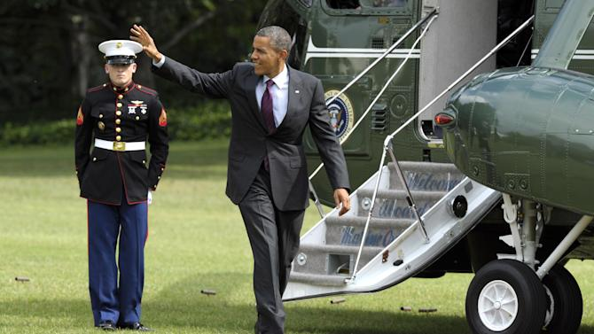 President Barack Obama walks to the Oval Office after arriving on Marine One on the South Lawn of the White House in Washington, Tuesday, Sept. 4, 2012. Obama is returning from campaigning in Norfolk, Va. (AP Photo/Susan Walsh)