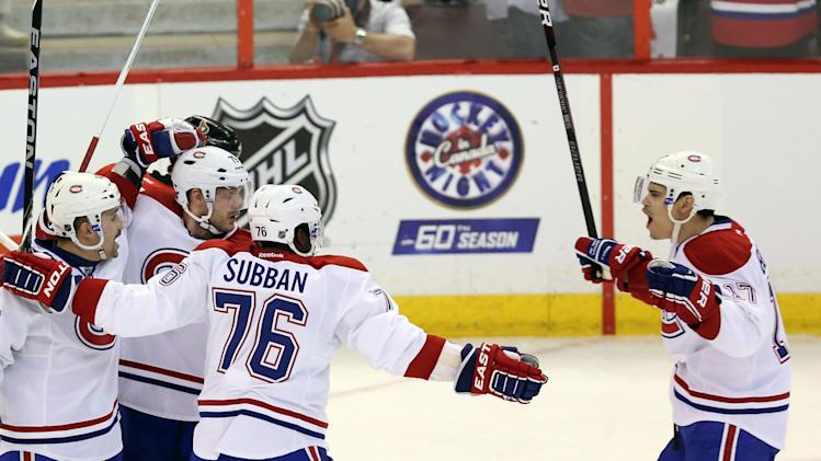 Montreal Canadiens' Rene Bourque (17) celebrates his goal with Andrei Markov (79) and P.K Subban (76) against the Ottawa Senators during the first period of Game 3 of their first-round NHL hockey Stanley Cup playoff series, Sunday, May 5, 2013, in Ottawa, Ontario. (AP Photo/The Canadian Press, Fred Chartrand)