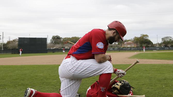 Non-roster invitee Russ Canzler selects a bat during a Philadelphia Phillies spring training baseball workout, Friday, Feb. 27, 2015, in Clearwater, Fla. (AP Photo/Lynne Sladky)