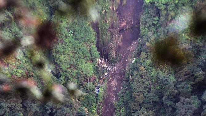 The wreckage of a Sukhoi Superjet-100 are scattered on the mountainside in Bogor,West Java, Indonesia, Friday, May 11, 2012. The new Russian-made passenger plane disappeared Wednesday during a demonstration flight with 47 people on board. (AP Photo)