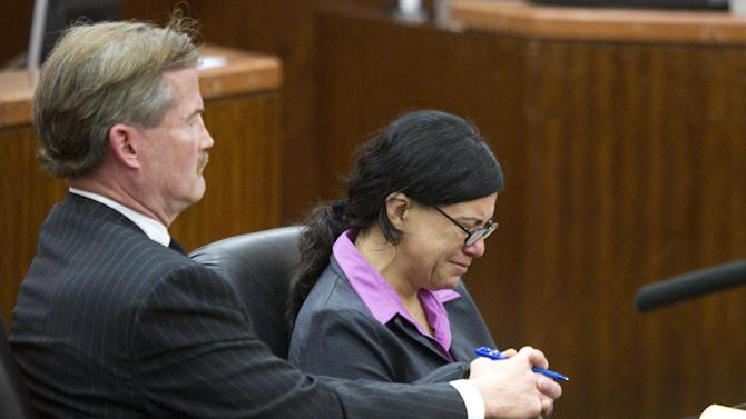 Ana Trujillo sits with her lawyer, Jack Carroll, during closing arguments in the punishment phase of her trial on Friday, April 11, 2014, in Houston. Trujillo was convicted on April 8, of murder for fatally stabbing her boyfriend 59-year-old Alf Stefan Andersson with the stiletto heel of her shoe during an argument last June at his Houston condominium. (AP Photo/Houston Chronicle, Brett Coomer) MANDATORY CREDIT