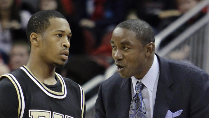 Florida International coach Isiah Thomas talks to guard Phil Gary (4) during a break in the second half of an NCAA college basketball game against Louisville in Louisville, Ky., Wednesday, Dec. 1, 2010. (AP Photo/Garry Jones)
