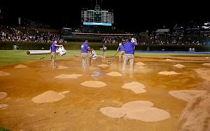 Cubs outlast Giants 2-0 in rain-shortened game