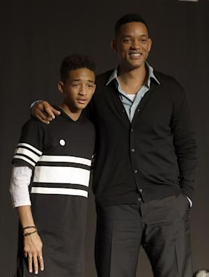 "FILE - In this May 7, 2013 file photo, U.S. actor Will Smith and his son Jaden pose for the media after press conference for their film ""After Earth"" in Seoul, South Korea. Both actors were awarded Razzies for the film. Jaden was selected as worst actor for his role in the sci-fi flop about a father and son stranded on an untamed earth, while the elder Smith was chosen as worst supporting actor at the Golden Raspberry Awards, on Saturday, March 1, 2014, which lampoons Hollywood's awards season on the eve of the Oscars. (AP Photo/Lee Jin-man, file)"