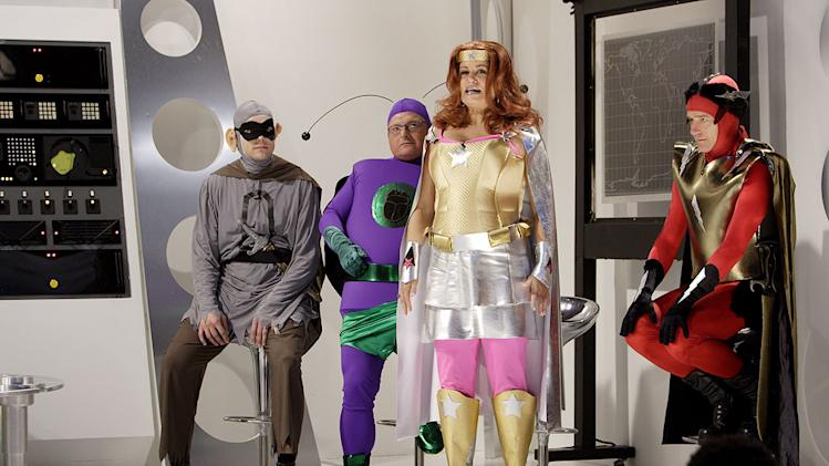 "Joel McHale, Wayne Knight, Jennifer Coolidge and Bryan Cranston as superheroes on ""Thank God You're Here."""