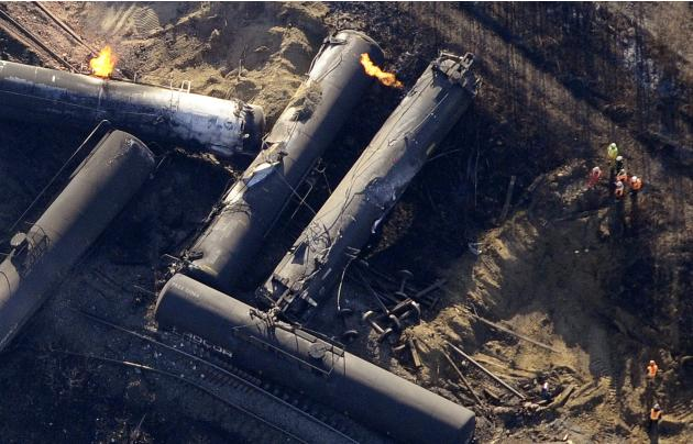 Investigators survey the site of a train derailment near the hamlet of Gainford, west of Edmonton
