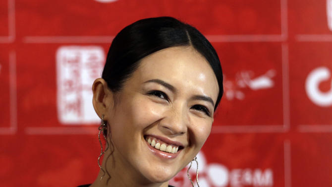 """FILE - In this Sunday, June 16, 2013 file photo, Chinese actress Zhang Ziyi smiles during the press conference for 2013 Chinese Film Festival in Seoul, South Korea. """"Crouching Tiger, Hidden Dragon"""" actress Zhang has reached an undisclosed settlement with a U.S.-based dissident news website that she had sued for libel. (AP Photo/Lee Jin-man)"""