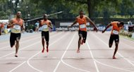 Tyson Gay of the USA (L) wins the Men's 100 meters heat B against (L-R) Aaron Armstrong of Trinidad, Kemar Bailey Cole of Jamaica and Jason Young of Jamaica at the 2012 Adidas Grand Prix race at Icahn Stadium on Randall's Island in New York