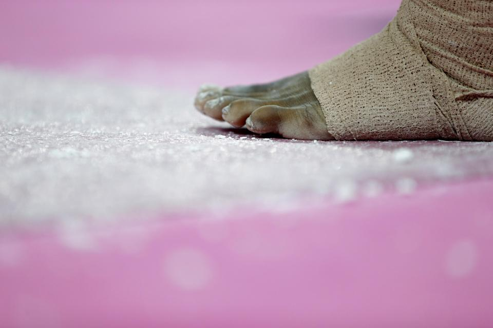 Chalk lie scattered near the feet of U.S. gymnast Jordyn Wieber during training at the 2012 Summer Olympics, Thursday, July 26, 2012, in London. (AP Photo/Julie Jacobson)